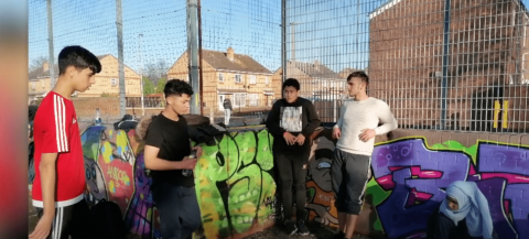 4 teenagers in a graffiti basketball court