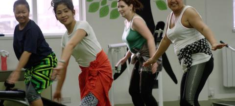 women having fun in an exercise class