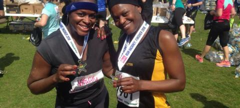 Two female participants with their athletic medals