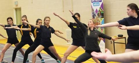 Girls having a go at dance activity