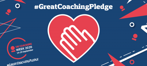 Graphic of heart with a hand in middle with text Great coaching pledge