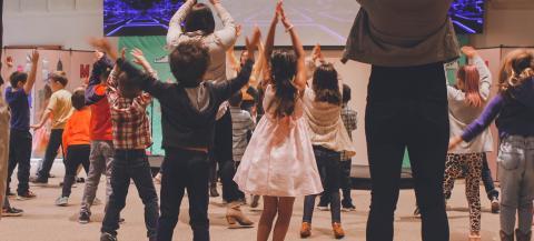 Children dancing in a hall