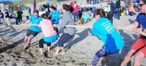 Tug of war competition on the beach