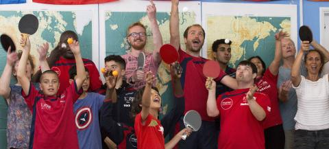 group of table tennis players cheering