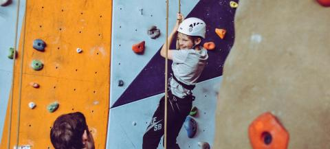 boy climbing Photo by Rachel on Unsplash
