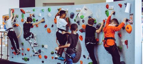 children on indoor climbing wall