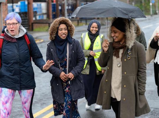 Group of women enjoying a walk in the rain