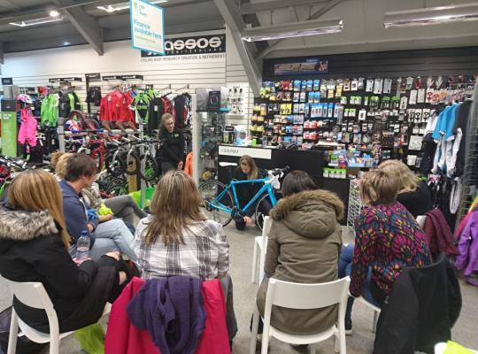 Women participating in bike maintenance workshop