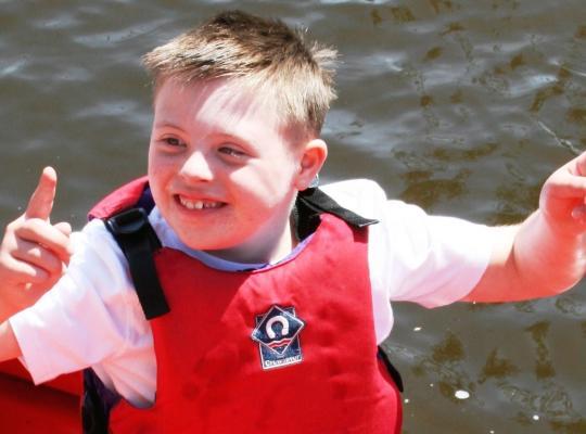 boy in sailing boat