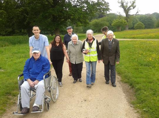 Group of people walking in countryside