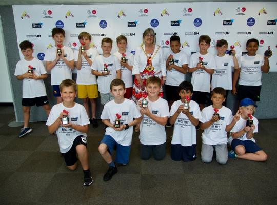 Young participants with their celebration trophies