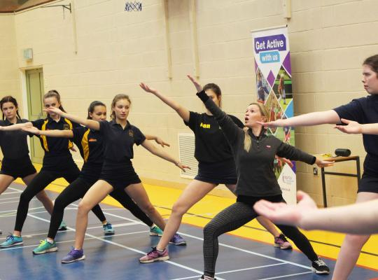 Girls having a go at dance activity