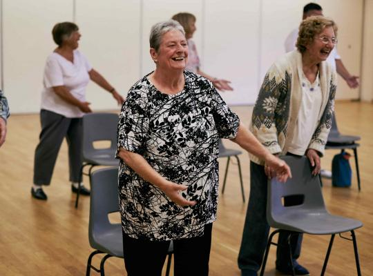 people taking part in a falls prevention class