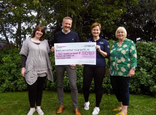 cheque presentation to the Active Partnership