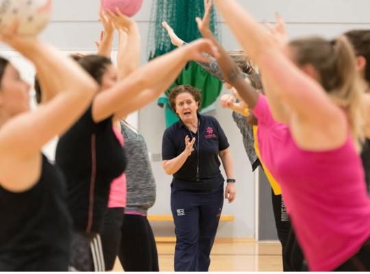 Female coach leading a Netball session