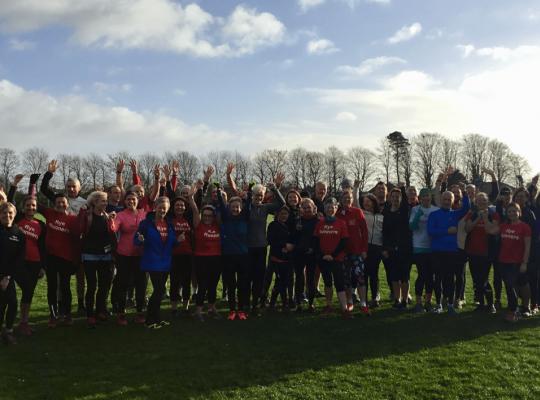 group of runners celebrating funding
