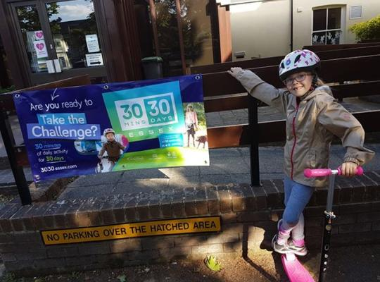 Girl on scooter by Poster advertising 30:30 campaign
