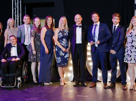 Herts Sports Partnership Team receiving award on stage