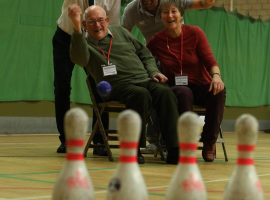 people participating in indoor skittles
