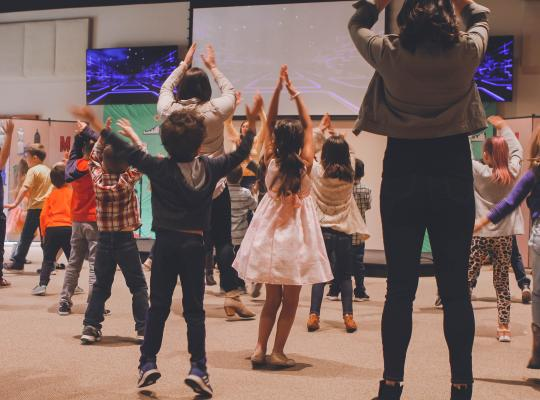 Children dancing in a hall
