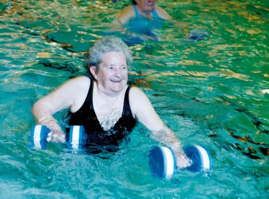 older female taking part in aqua fit
