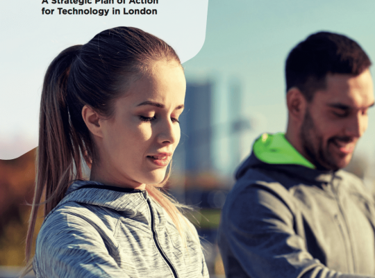 front cover of report showing two people looking at running watches