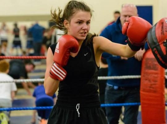 females boxing in a rink
