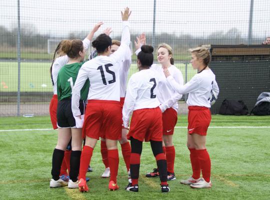 Girls playing football