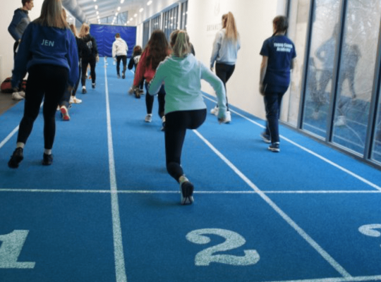 Young leaders involved in athletics warm up