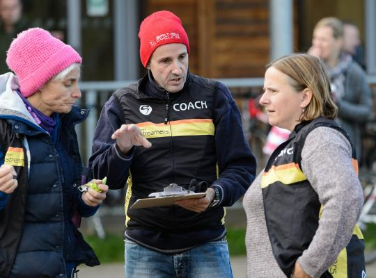 cycling volunteers and coaches helping at an event