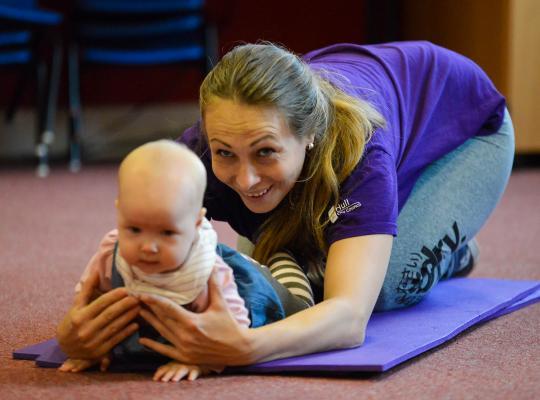 Mum exercising with baby