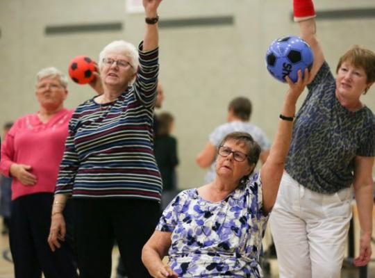 People joining in exercise class