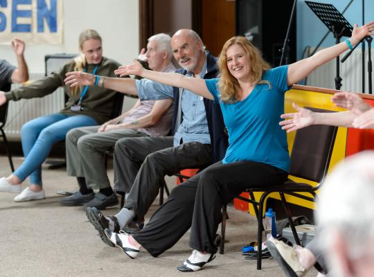 people participating in a seated exercise class