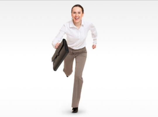 female running in business clothes