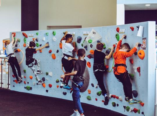 children on indoor climbing wall
