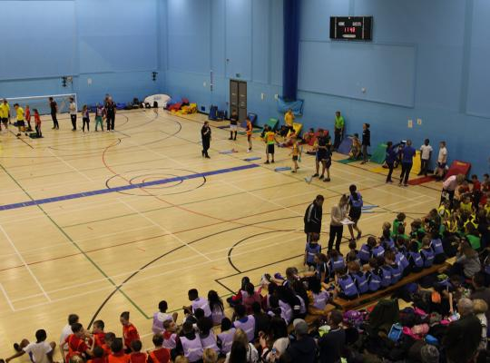 children participating in sports hall competition